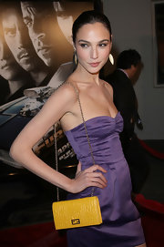Gal Gadot's yellow Fendi bag made a striking color contrast to her purple dress at the 'Fast & Furious' premiere.