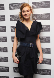 Imogen Poots wore a stylish navy belt with a beaded buckle to the BFI London Film Festival premiere of 'Cracks.'