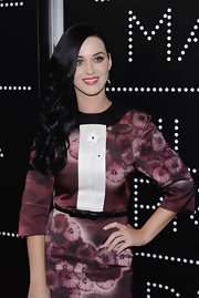 Katy Perry paired a bowed black belt with a burgundy floral dress for the 'Gatsby' opening cocktail party.