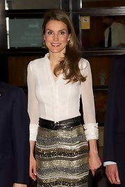 Princess Letizia topped off her button-down/beaded skirt combo with a chic black leather belt for a concert at the Royal Theater.