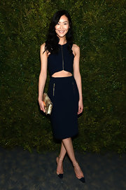 Liu Wen polished off her look with a Michael Kors Quinn clutch in nude python.