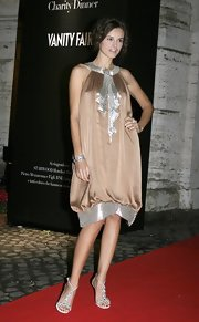 Kasia Smutniak kept the sparkle going with a pair of bejeweled T-strap sandals.