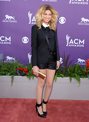 Tori Kelly showed off her stems in leather shorts with matching ankle strap heels.