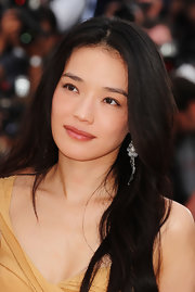 Shu Qi wore a natural lipgloss color on her lips to match her laid-back makeup look at the Cannes Film Festival Jury Press Conference.