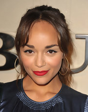Ashley Madekwe paired her 'do with large gold hoops.