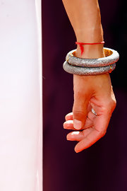 Lisa accessorized with two silver bangle bracelets.