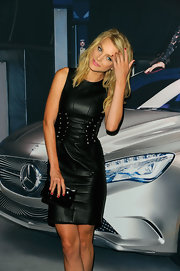 Jessica Stam was spotted during Mercedes-Benz Fashion Week rocking an all-black leather clutch and dress combo.