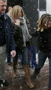 Jennifer Aniston went out and about during the Sundance Film Festival wearing a pair of tan wedge boots.