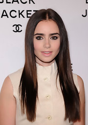 Lily Collins wore her hair super long and pin-straight at the Chanel Little Black Jacket event.