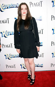 Kat Dennings completed her conservative attire with black peep-toe pumps.