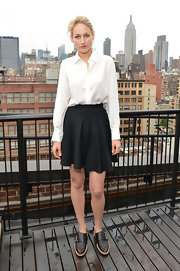 Leelee Sobieski paired her shirt with a flirty black mini skirt for a more feminine finish.