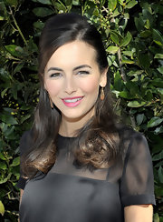 Camilla Belle sported a retro-glam half-up 'do with a teased crown and curly ends at the UNICEF Women of Compassion luncheon.