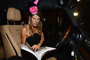 Anna dello Russo looked dazzling at the CR Magazine launch wearing this rose and mesh fascinator by Philip Treacy for Alan Journo.