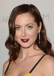 Eva channeled old Hollywood glamour with her deep berry lips at a gala in Los Angeles.