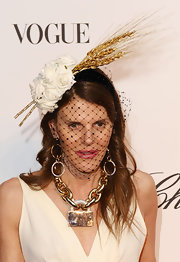 Anna dello Russo turned heads with her wheat and flower fascinator during the Fashion for Relief event.