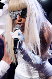 Lady Gaga completed her all-white outfit with a pair of leather gloves.