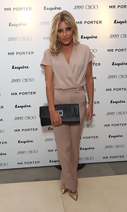 Mollie King paired her outfit with a black woven-leather clutch, also by Reiss.
