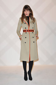 Lou Doillon looked fiercely chic in a leather-trimmed trenchcoat by Burberry Prorsum during the brand's Paris boutique opening.