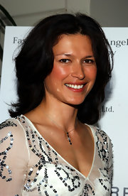Karina Lombard accessorized with a delicate lariat necklace.