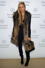 Joanna Hillman toughened up her fur coat with a pair of black patent lace-up boots.