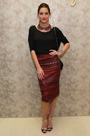 Hilary Rhoda finished off her snazzy ensemble with a Dannijo collar-shaped necklace that echoed the style of her skirt.