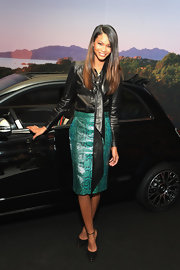 Chanel Iman was edgy-elegant in a black leather tie-neck top during Gucci's celebration of Fashion's Night Out.
