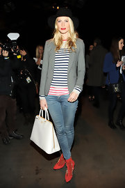 Poppy Delevingne was casual-chic in a monochrome blazer layered over a striped shirt at the Rag & Bone fashion show.