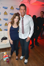 Anna Kendrick showed off some cleavage in a low-cut blue tank top during the Holiday Tech Bash.