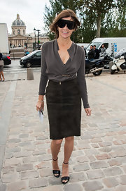 Carine Roitfeld paired her cardigan with a black suede pencil skirt for a more stylish finish.