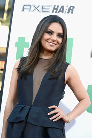 Mila Kunis accessorized with an elegant gold bracelet by Dior at the premiere of 'Ted.'