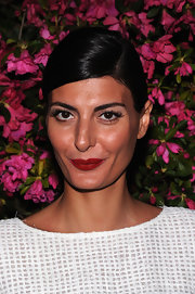 Giovanna Battaglia sported a sleek and elegant side-parted chignon at the Chanel Tribeca Film Festival Artists Dinner.