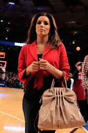 Eva Longoria watched a basketball game looking cute in a red cropped jacket.