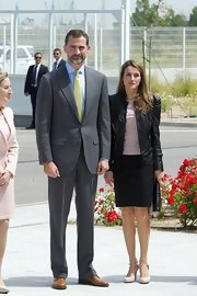 Nude pumps with double ankle straps completed Princess Letizia's tough-chic look.