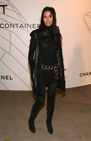 For her footwear, Padma Lakshmi chose a pair of black over-the-knee boots.
