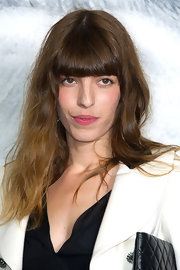 Lou Doillon stuck to her signature disheveled waves and blunt bangs when she attended the Chanel fashion show.