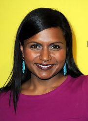 Mindy Kaling's dangling turquoise earrings and purple dress were a gorgeous pairing.