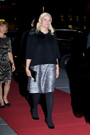 Princess Mette-Marit paired a black swing jacket with a metallic cocktail dress for an event at the National Opera House.