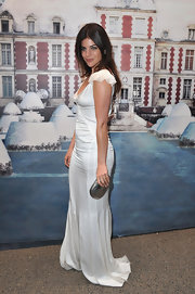 Julia Restoin-Roitfeld added shine to her outfit with a metallic silver clutch.