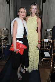 Elisabeth von Thurn und Taxis accessorized with an oversized red leather clutch at the Valentino Couture Fall 2012 show.