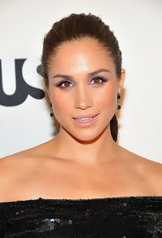 Meghan Markle made her eyes pop with some amethyst eye shadow.