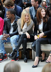 Sienna Miller was spotted front row at the Burberry fashion show wearing a pair of black wedge booties from the brand.