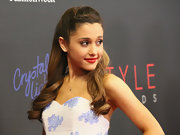 Ariana Grande wore her hair in lovely half-up half-down style with spiral curls during the Style Awards.