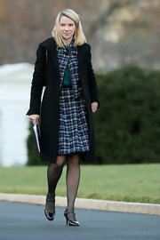 Marissa Mayer kept warm in classic style with a black wool coat layered over a tweed skirt suit during a meeting at the White House.