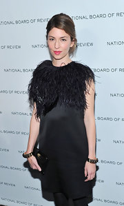 Sofia Coppola complemented her feathered LBD with a duo of bangles for the National Board of Review of Motion Pictures Gala.