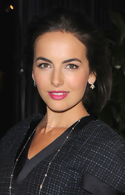 Camilla Belle swept her hair back into a poufy updo for the Chanel pre-Oscar dinner.