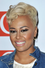 Emeli Sande hovered between sweet and edgy wearing this curly fauxhawk at the Q Awards.