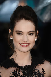 Lily James attended the EE British Academy Film Awards wearing her hair in a classic loose bun.