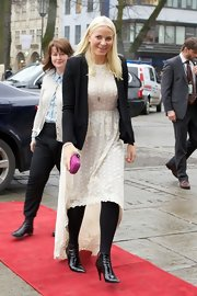 Princess Mette-Marit topped off her frock with a black blazer.