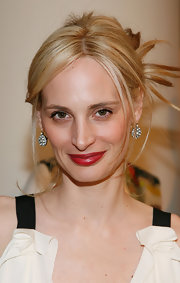 Lauren Santo Domingo kept her beauty look minimal except for a splash of rich red on the lips.