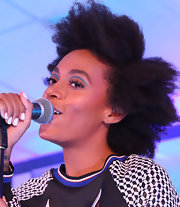 Solange Knowles performed at uncapped wearing a funky curly 'do.